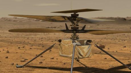 Diese von der NASA zur Verfügung gestellte Illustration zeigt den Mini-Hubschrauber «Ingenuity» auf der Marsoberfläche.
